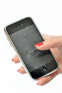 5249770-girl-with-red-nails-holding-a-mobile-phone-with-broken-screen